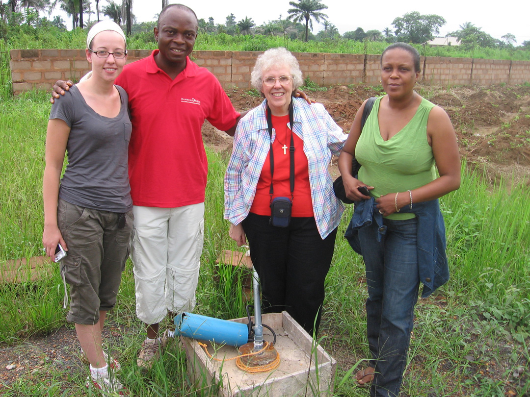 Chris Okorie with Lindsy, Sr. Dolores and Dominique at the water pump site in Obinagu